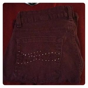 A pair of burgundy jeans size 12